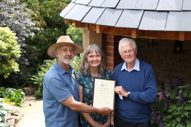 Andy and Cathy Adams receiving a Malvern Civic Award Highly Commended certificate for their charming garden gazebo at 24 Croft Bank, West Malvern.
