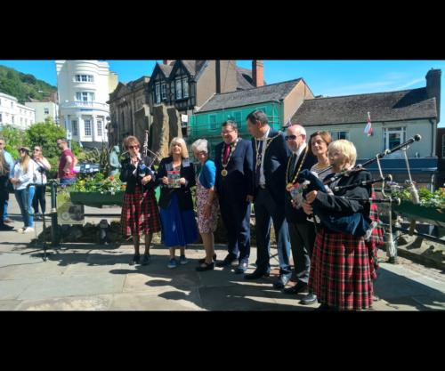 The dignitaries and pipers